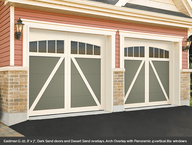 Eastman E 22 Garaga garage door in Dark Sand with Desert Sand Arch Overlays and Panoramic 4 lite vertical windows