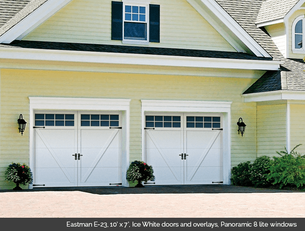 Eastman E 23 Garaga garage door in Ice White with Ice White Overlays and Panoramic 8 lite windows