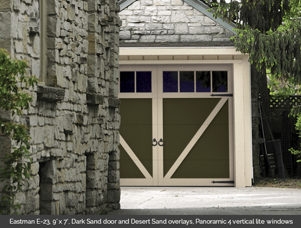 Eastman E 23 Garaga garage door in Dark sand with Desert Sand Overlays and Panoramic 4 lite vertical windows