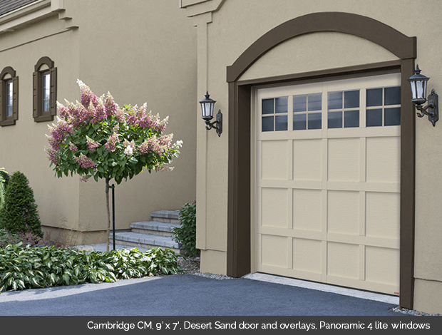 Cambridge CM Desert Sand Garaga garage door with Desert Sand overlays and Panoramic 4 lite windows