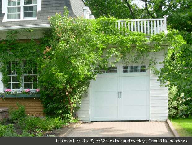 Eastman E-11 Ice White Garaga garage doors with Ice White overlays and Orion 8 lite windows