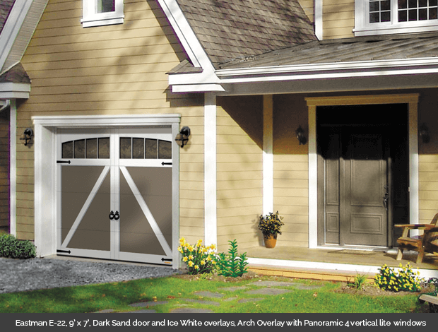 Eastman E 22 Garaga garage door in Dark Sand with Ice White Arch Overlays and Panoramic 4 lite vertical windows