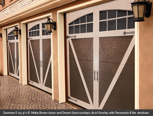 Eastman E 23 Garaga garage door in Moka Brown with Desert Sand Arch Overlay and Panoramic 8 lite windows