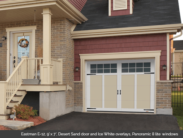Eastman E-12 Desert Sand Garaga garage doors with Ice White overlays and Panoramic 8 lite windows