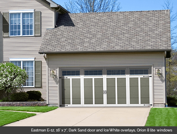 Eastman E-12 Dark Sand Garaga garage doors with Ice White overlays and Orion 8 lite windows