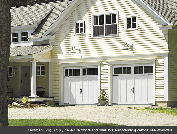 Eastman E-13 Ice White Garaga garage doors with Ice White overlays and Panoramic 4 vertical lite windows