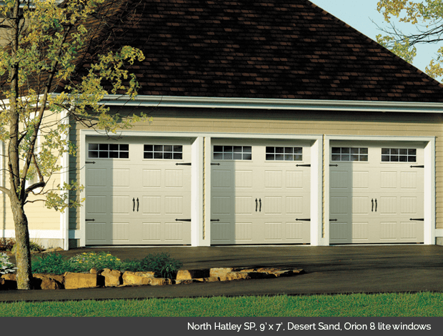 North Hatley in Desert Sand Garaga garage door with Orion 8 lite windows